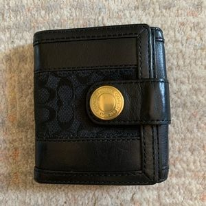 Black leather and canvas Coach billfold wallet